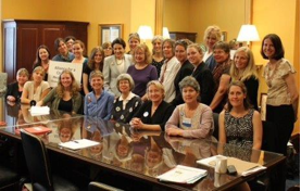Picture of moms and activists talking with Senator Snowe